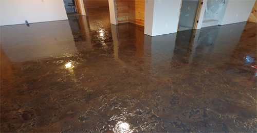 Stained basement floors concrete restoration systems for Cleaning stained concrete floors steam mop